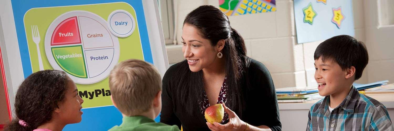 teacher talking with kids