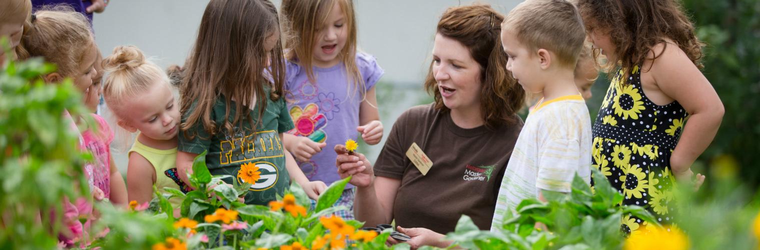 teaching children about plants in garden